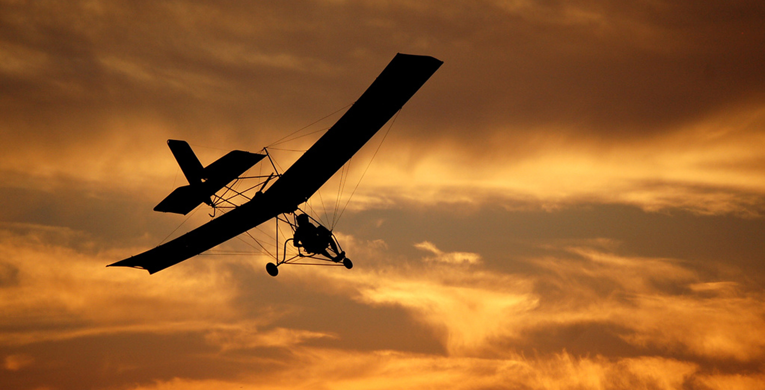 Microlight flying at Sunset - Brown Shutters Farm Airfield